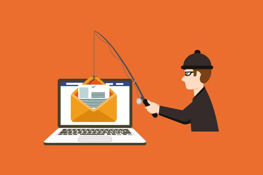 personne péchant un mail dans un ordinateur portable